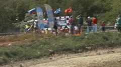 Professional Motocrosser on the Bike Makes the Circle During a Race With Jumps Stock Footage