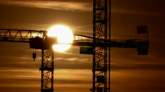 Time lapse of sunset. build develop growth background. construction cranes Stock Footage