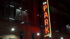 Parking garage sign in city advertising 24 hour operation 4k Stock Footage