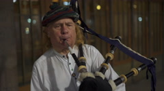 Bagpipe street entertainer playing at entrance to Grand Central Terminal NYC Stock Footage