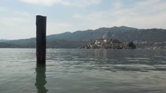 Orta lake and san giulio island in italy in summer day Stock Footage