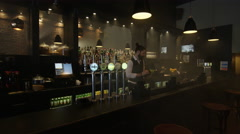 4K Bartender wiping down the bar & setting up ready for opening time Stock Footage
