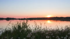 Timelapse of a sunset on the lake in summer Stock Footage