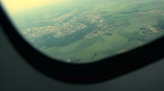 Airplane window view. flight flying airborne. plane aircraft. in the air Stock Footage