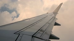 Airplane window view. wing of plane. windy stormy flying conditions Stock Footage