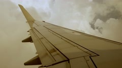 Flying trough storm clouds. airplane window view. travel background Stock Footage