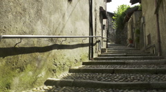 Alley in mergozzo old town centre in summer day  dolly Stock Footage