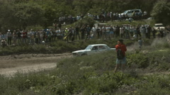Rally Cars Over Rough Terrain. Motor Racing on a Clear Sunny Day Stock Footage