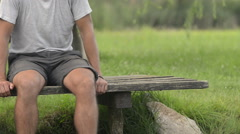 Young man in nature relax seated on lake jetty in summer day outdoor Stock Footage