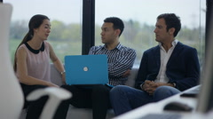 4K Business team talking in modern office, looking at laptop & discussing ideas Arkistovideo