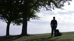 Young man silhouette with backpack star a walk in nature Stock Footage