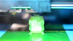 3D printer creates three-dimensional shape green Stock Footage