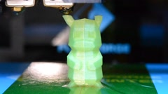3D printer creates three-dimensional shape green - stock footage