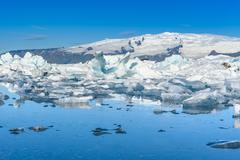 Scenic view of icebergs in glacier lagoon, Iceland - stock illustration