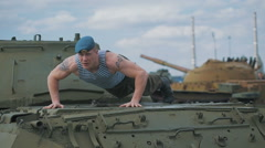 The soldier pushed on the tank. Training on a military base Stock Footage