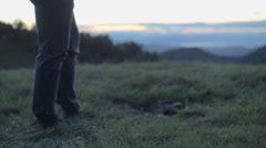 Close up of young man legs in nature mountain outdoor at sunrise or sunset Stock Footage