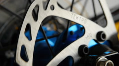 Bicycle disk brake rotor in focus - stock footage