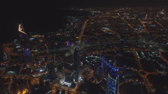 Kuwait city at night with a bird's-eye view Stock Footage