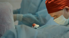 Surgeons team operates with the patient Stock Footage