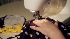 Close up shot of a tailor behind a sewing machine Stock Footage