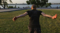 Parkour man run and jump in city at sunset Stock Footage