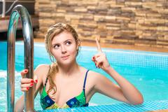 the girl in a bathing suit is a great idea - hand gesture - stock photo