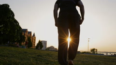 Freerun man run and jump in city at sunset Stock Footage