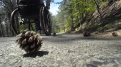 Man Pushing A Wheelchair Up The Road Stock Footage
