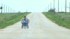 Traveling Man In Wheelchair Give Five Stock Footage
