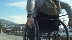 Paralyzed Man Using His Wheelchair Stock Footage
