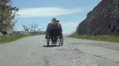 Traveler Disabled Man On Mountain Road - stock footage