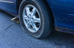 Flat tire on the road - stock photo