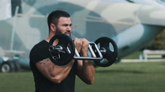 Strength training at a military base Stock Footage