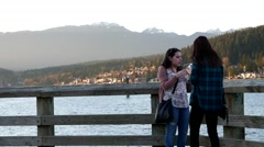 People eating ice cream on the dock at Rocky point park in Port Moody Stock Footage