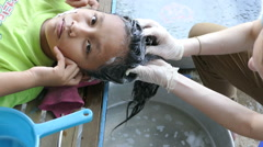 Cambodian Teen Gets Delousing Shampoo From Youth Missions Team Stock Footage