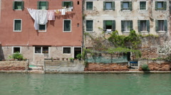 Colored traditional buildings on Venice canal in Italy Stock Footage