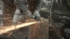 Welder at work. repairing machine Stock Footage