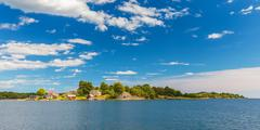 Panoramic image of a small swedish island with old houses - stock photo