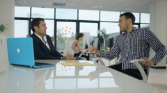 4K Business manager in meeting with client introduces him to employee Stock Footage