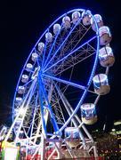 Amusement park attractions. Ferris wheel at night Kuvituskuvat