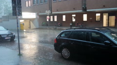 4k Heavy rain and thunderstorm street scene in german city Stock Footage