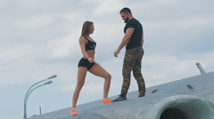 Lovers man and woman dressed in military style Stock Footage