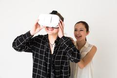 Two teenagers wearing virtual reality headset - stock photo