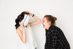 Laughing with virtual reality game - stock photo
