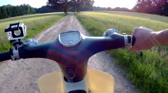 riding classic 70`s moped in rural enviroment - stock footage