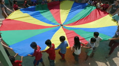 Cambodian Kids Having Fun Playing With Parachute In The Slums Stock Footage
