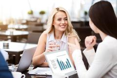 Nice smiling delighted colleagues talking - stock photo