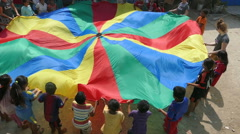 Cambodian Kids In Slum Playing With Parachute Stock Footage