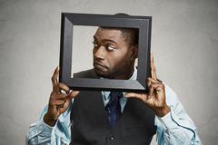 Closeup portrait businessman executive looking sideways, curious surprised co Stock Photos