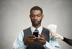 Busines man using smart phone, while offered financial reward Stock Photos